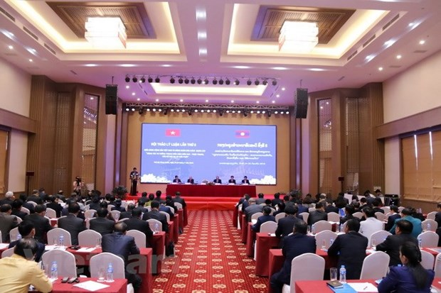Vietnamese, Lao parties hold theoretical workshop hinh anh 2