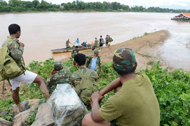 Laos dam collapse: rescuers searching for missing victims hinh anh 1