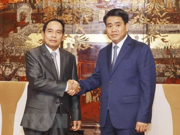 Hanoi, Lao officials share experiences in inspection work hinh anh 1