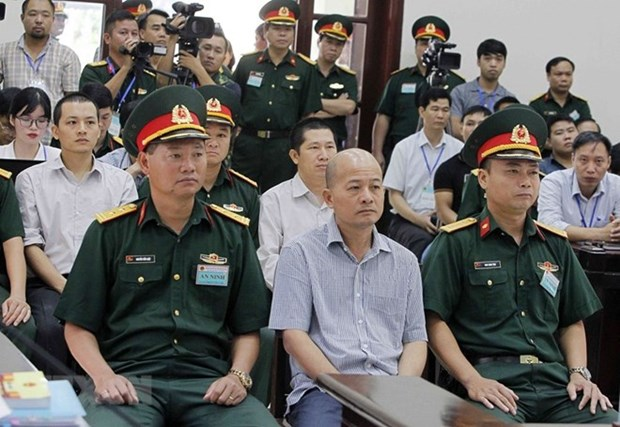 Former senior lieutenant colonel tried for abusing position, power hinh anh 1