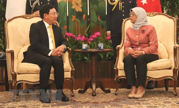 Deputy PM Pham Binh Minh meets Singaporean leaders hinh anh 1
