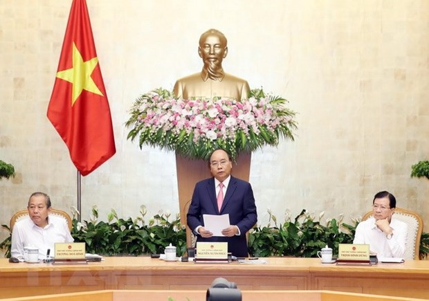 PM affirms resolve to control inflation amid big pressure on CPI hinh anh 1