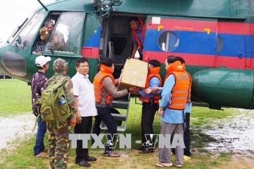 Defence ministry supports Laos to recover from dam collapse hinh anh 1