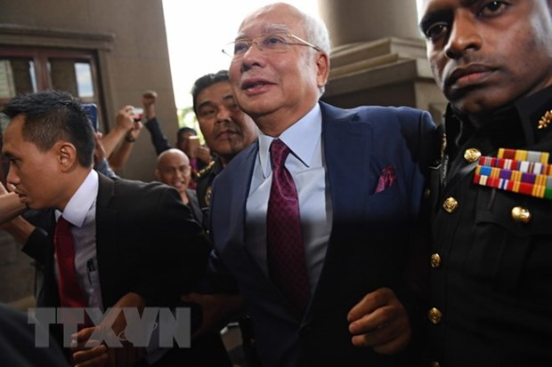 Former Malaysian PM faces fresh charges of money laundering hinh anh 1