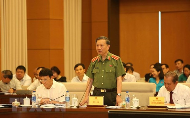 Security minister answers issues on criminal offense hinh anh 1