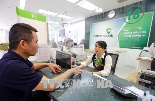 Moody's upgrades ratings of 14 Vietnamese banks hinh anh 1