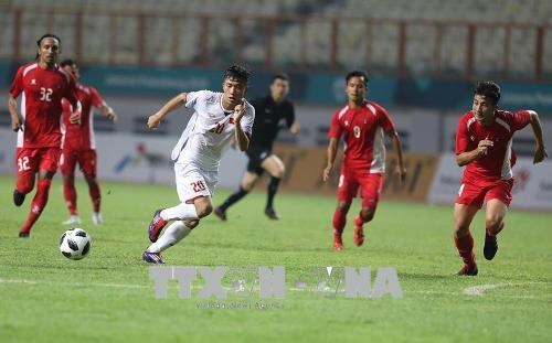 ASIAD 2018: Vietnam beats Nepal 2-0, qualifying for next round hinh anh 1