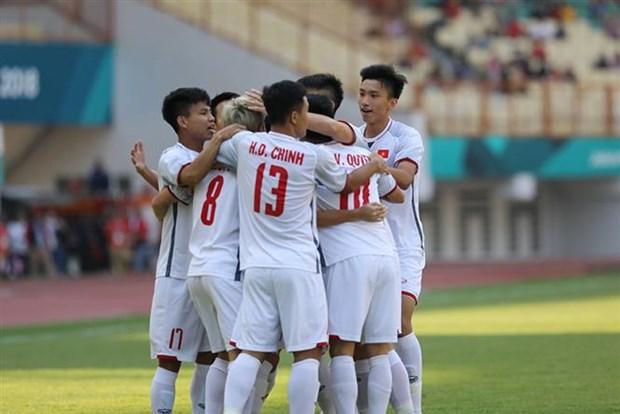 ASIAD 2018: Vietnam beats Japan, topping Group D hinh anh 1