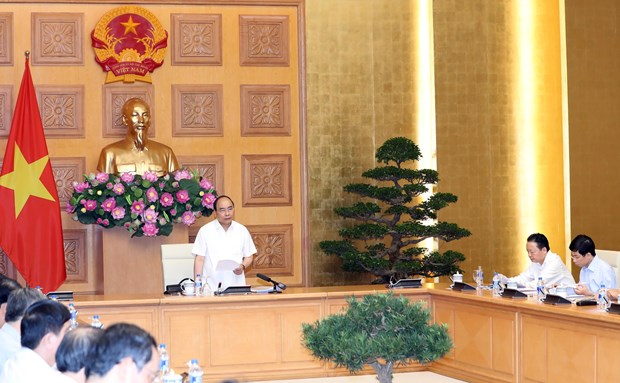 PM chairs meeting on urgent house rebuilding support for flood victims hinh anh 1