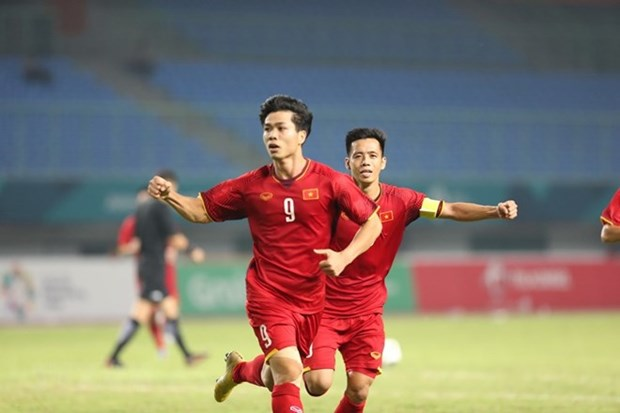 ASIAD 18: Asian media spotlight Vietnam Olympic's historic win hinh anh 1