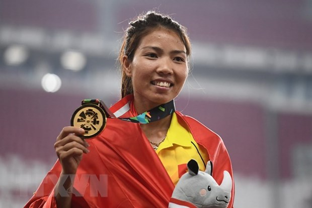 Vietnamese athlete rewarded after winning gold medal hinh anh 1