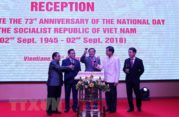 National Day marked in Laos, Mozambique hinh anh 1
