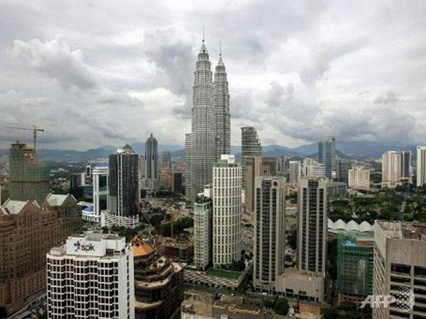 Standard Chartered lowers growth forecast for Malaysia hinh anh 1