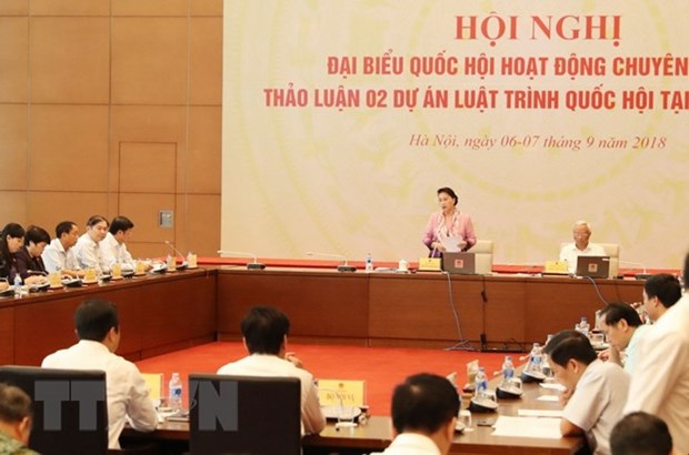 Full-time NA deputies meet to discuss bills on anti-corruption, higher education hinh anh 1