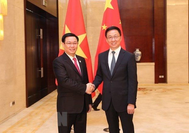 Deputy PM Vuong Dinh Hue holds talks with Chinese Vice Premier hinh anh 1