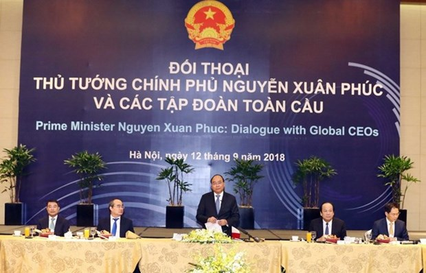 WEF ASEAN 2018: PM holds dialogue with global corporation leaders hinh anh 1