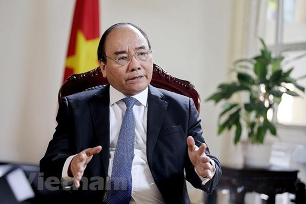 PM Nguyen Xuan Phuc's interview to Singapore's The Straits Times hinh anh 1