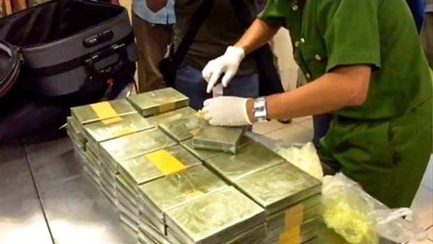 Quang Tri border guard, Lao forces arrest drug dealers hinh anh 1