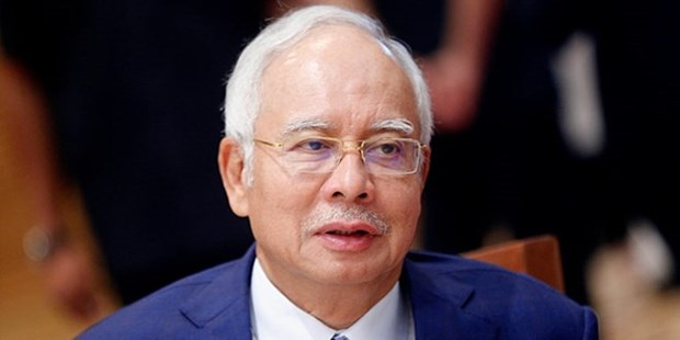 Former Malaysian PM arrested for new corruption charges hinh anh 1