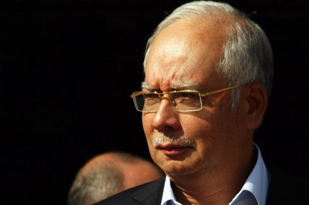 Former Malaysian PM Najib Razak charged with money laundering, power abuse hinh anh 1