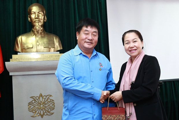 Trade Union Vice President receives Lao counterpart hinh anh 1
