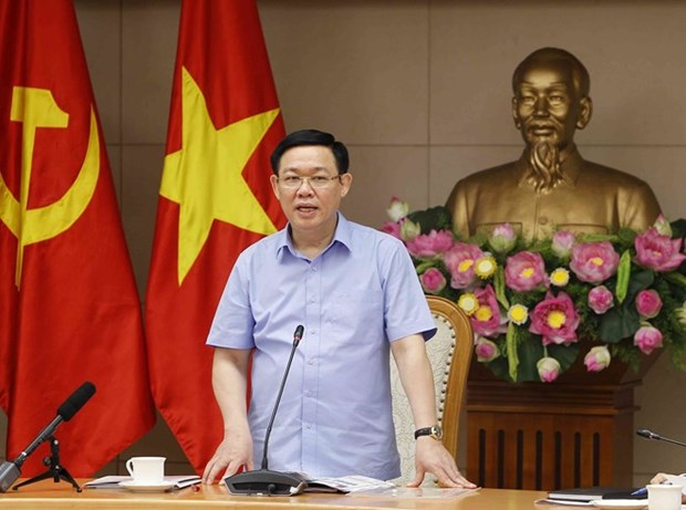 Experts review monetary policy for third quarter hinh anh 1
