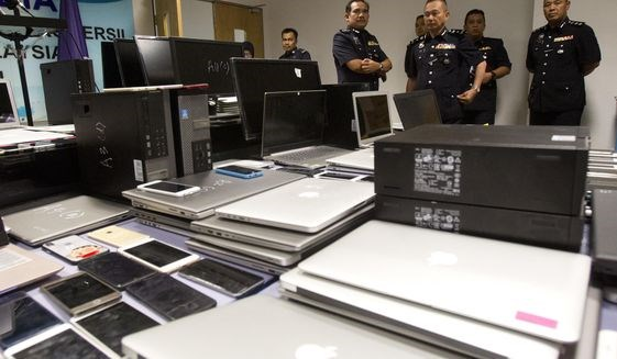 Malaysian police bust major phone swindle ring hinh anh 1