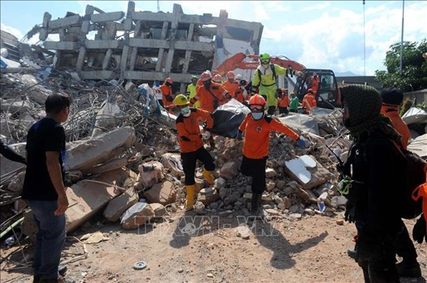 Indonesia: quake-tsunami death toll reaches 1,407 hinh anh 1