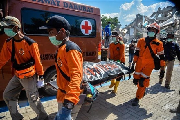 Indonesia: Quake-tsunami casualties exceed 1,500 hinh anh 1