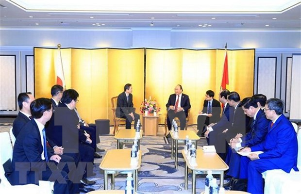 PM pledges to improve business climate for Japanese investors hinh anh 1