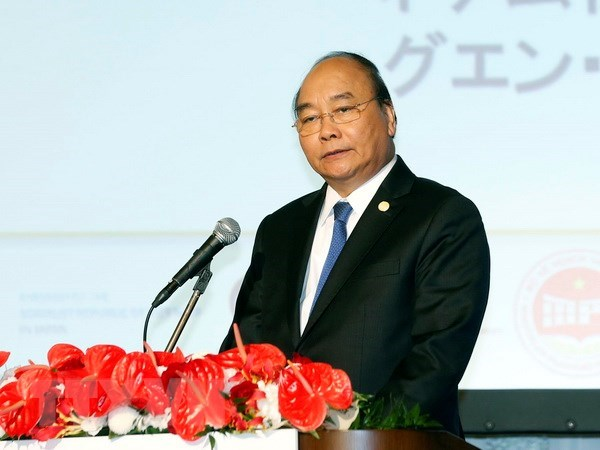 PM encourages Japanese firms to invest in Vietnamese SOEs hinh anh 1