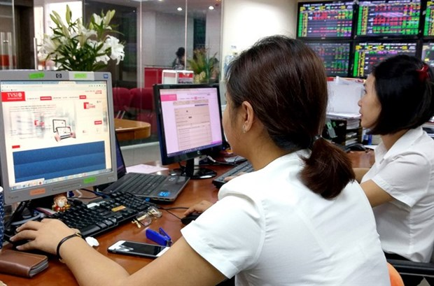 Local shares end down on late sell-offs hinh anh 1