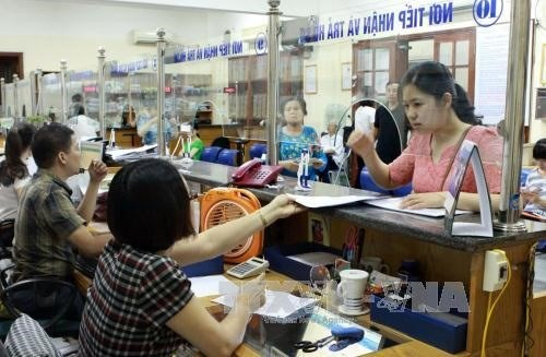 Informal workers wary of opt-in social insurance hinh anh 1