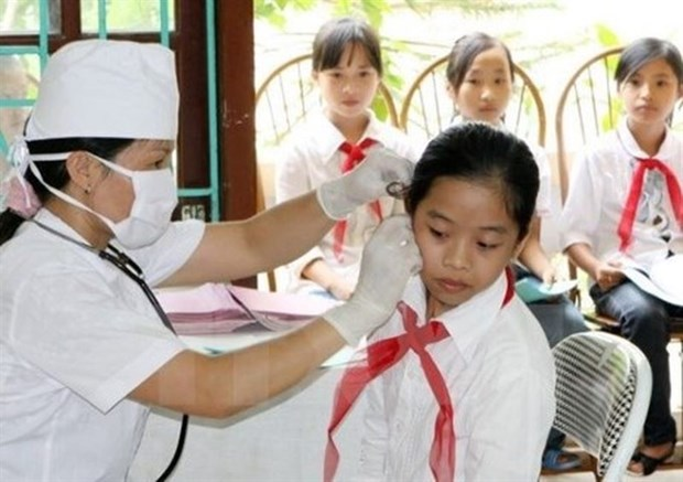 HCM City targets 98 pct health insurance coverage for students hinh anh 1