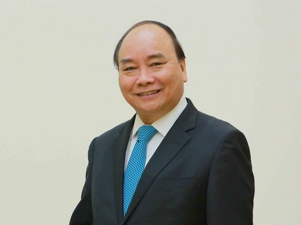 PM Nguyen Xuan Phuc leaves for China's first international import expo hinh anh 1