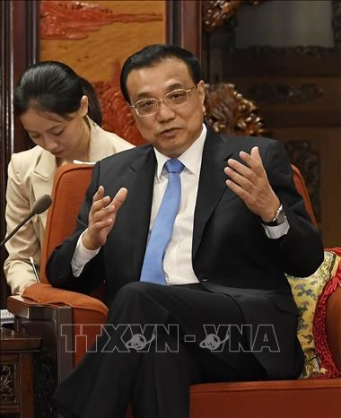 China wants to lift cooperation with Singapore hinh anh 1