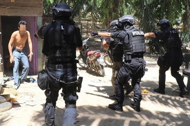 Malaysian police arrest eight terrorist suspects hinh anh 1