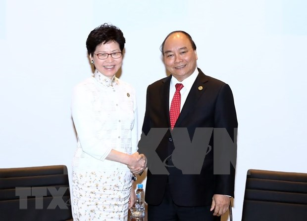 PM Phuc meets with New Zealand, Hong Kong leaders on APEC sidelines hinh anh 1