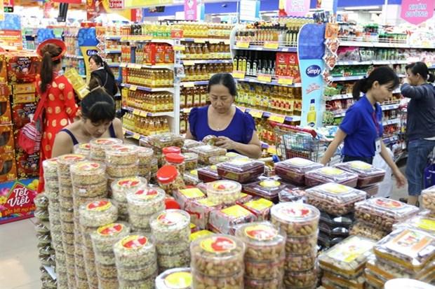 Hanoi, HCM City spend 47 trillion VND on Tet goods hinh anh 1