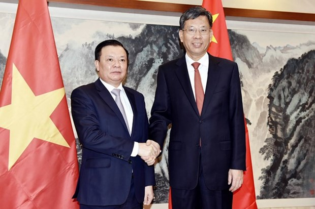 Vietnam, China seek to step up financial cooperation hinh anh 1