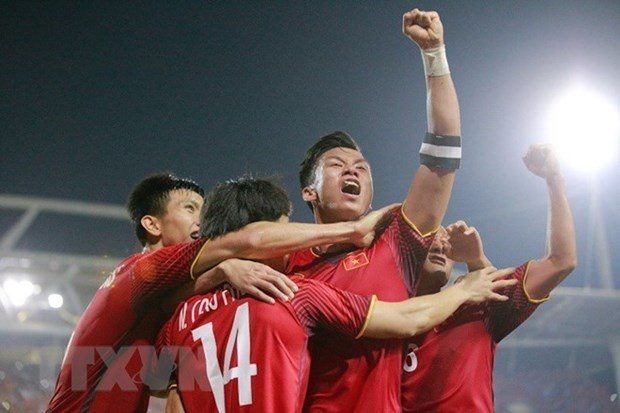 Asian media laud Vietnam's victory at AFF Suzuki Cup semifinals hinh anh 1
