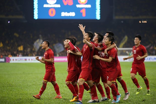 Vietnam tie with Malaysia in AFF first-leg final hinh anh 1