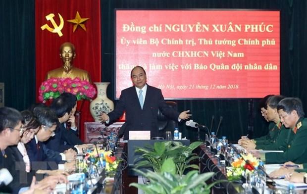PM hails Quan doi Nhan dan newspaper for national contributions hinh anh 1