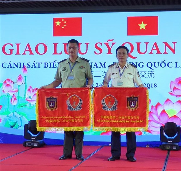 Vietnam, China coast guards join exchange programme hinh anh 1