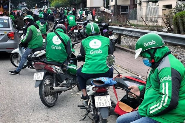 Grab's acquisition of Uber scrutinised hinh anh 1