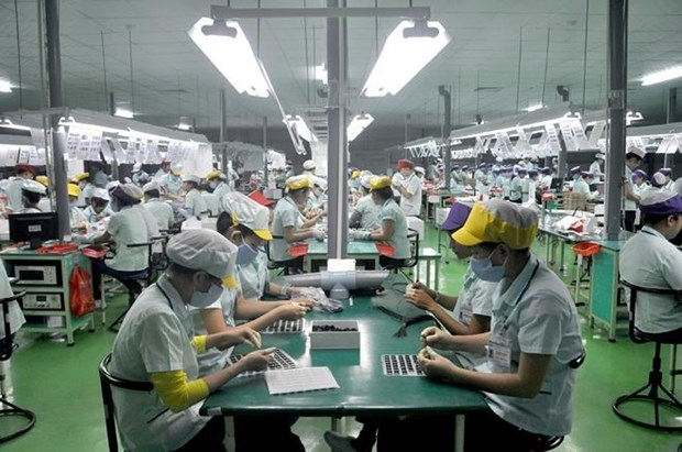 Vietnam to keep outperforming region: Fitch Solutions hinh anh 1