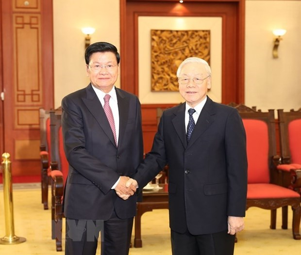 Top Vietnamese leader welcomes Lao Prime Minister hinh anh 1