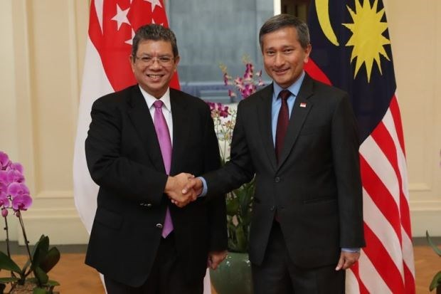 Singapore, Malaysia agree on measures to ease air, sea tensions hinh anh 1