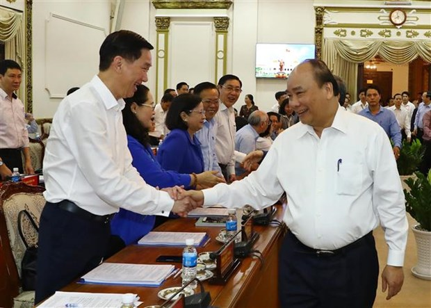PM chairs review of pilot mechanisms for HCM City hinh anh 1