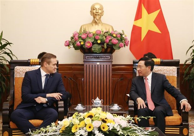 Deputy PM Pham Binh Minh receives Lithuanian interior minister hinh anh 1